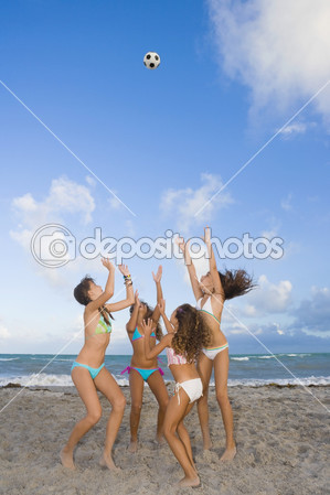 Прикрепленное изображение: depositphotos_52081115-Multi-ethnic-girls-playing-with-soccer-ball-at-beach.jpg